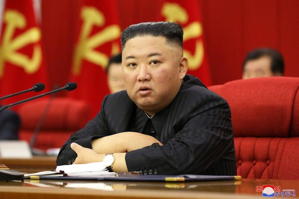 File: A photo released by the official North Korean Central News Agency (KCNA) shows Kim Jong-un presiding over a meeting in Pyongyang, North Korea on 18 June 2021 (EPA)