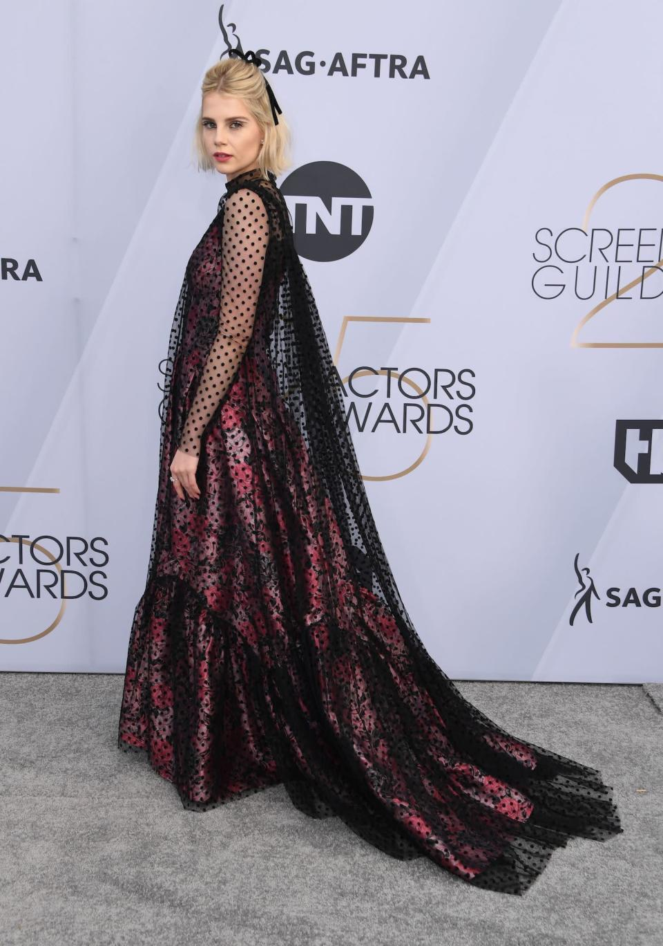 <p>Lucy Boynton, who is in the nominated film <em>Bohemian Rhapsody</em>, walked the silver carpet at the 2019 SAG Awards. (Photo: Getty Images) </p>