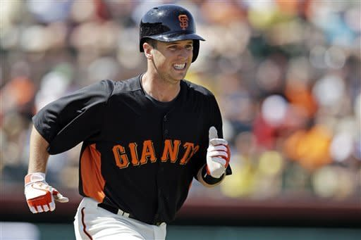 San Francisco Giants' Buster Posey runs to first base on a ground out against the Los Angeles Dodgers during the fourth inning of a spring training baseball game, Wednesday, March 28, 2012, in Scottsdale, Ariz. (AP Photo/Marcio Jose Sanchez)