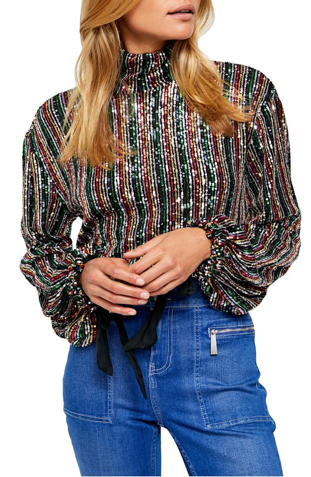 """$128, Nordstrom. <a href=""""https://shop.nordstrom.com/s/free-people-midnight-city-sequin-top/5439385/full"""">Get it now!</a>"""