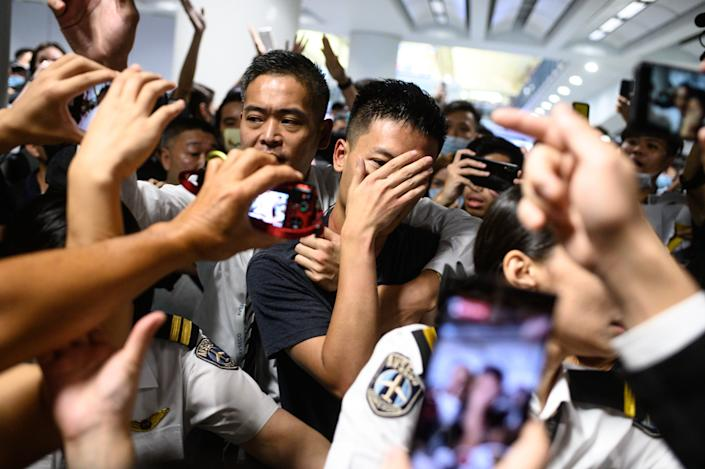 An unidentified man (C) is shouted at by protesters during a demonstration at Hong Kong's International Airport on August 13, 2019. (Photo: Philip Fong/NurPhoto via Getty Images)