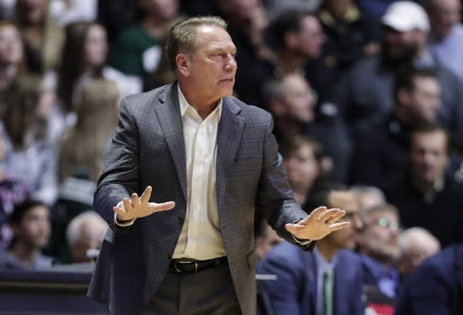 FILE - In this Jan. 12, 2020, file photo, Michigan State coach Tom Izzo gestures during the second half of the team's NCAA college basketball game against Purdue in West Lafayette, Ind. Michigan State basketball coach Tom Izzo has tested positive for COVID-19. The schools athletic department made the announcement Monday, Nov. 9, 2020. (AP Photo/Michael Conroy, File)