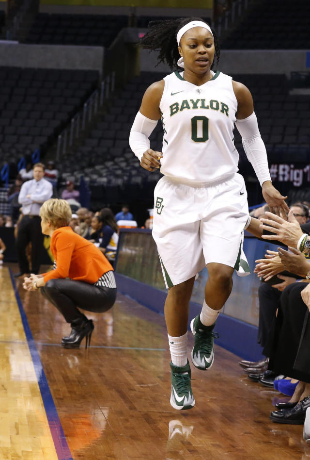 Baylor guard Odyssey Sims (0) hops off the court with an ankle injury in the first half of an NCAA college basketball game against West Virginia in the finals of the Big 12 Conference women's college tournament in Oklahoma City, Monday, March 10, 2014. Sims overcame the injury and scored 19 points as Baylor won 74-71. (AP Photo/Sue Ogrocki)