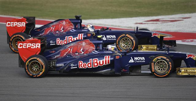 Toro Rosso driver Daniel Ricciardo of Australia, foreground, and teammate Daniel Ricciardo of Australia race side by side during the first practice session for the Formula One U.S. Grand Prix auto race at the Circuit of the Americas, Friday, Nov. 15, 2013, in Austin, Texas. (AP Photo/Eric Gay)