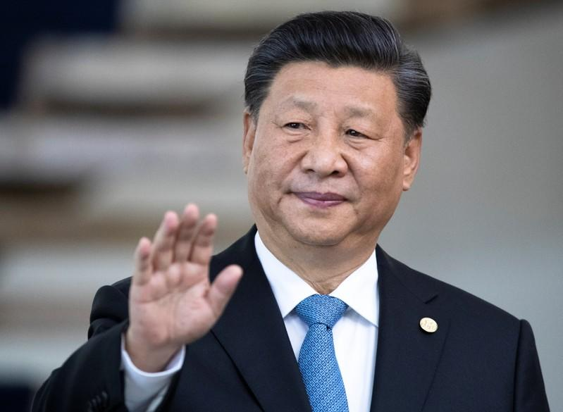 China's Xi says he wants to work out initial trade deal with U.S