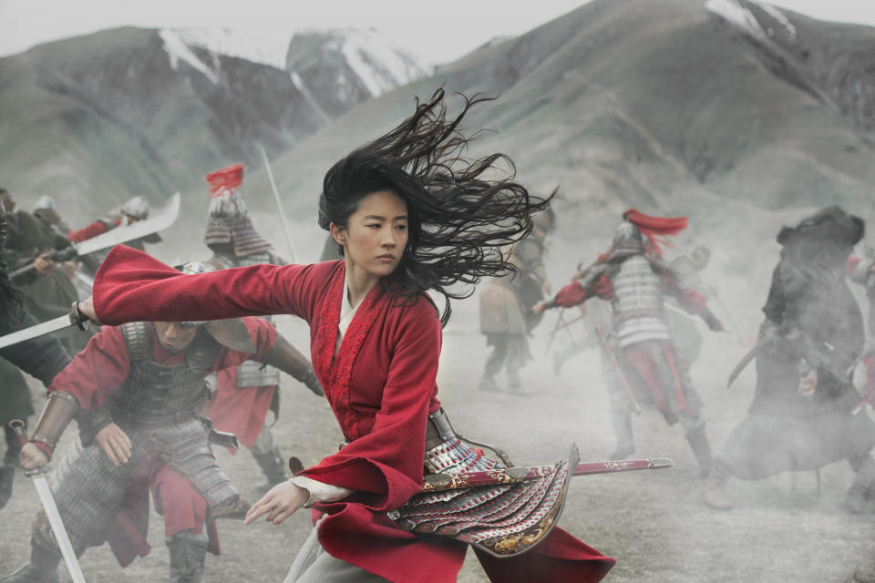 """This image released by Disney shows Yifei Liu in the title role of """"Mulan."""" Last month, Walt Disney Co. experimented with the $200 million """"Mulan"""" as a premium buy on its fast-growing streaming service, Disney+, where the Pixar film """"Soul"""" will also go on Dec. 25. WarnerMedia last week announced that """"Wonder Woman 1984"""" -- a movie that might have made $1 billion at the box office in a normal summer -- will land in theaters and on HBO Max nearly simultaneously next month. (Jasin Boland/Disney via AP)"""