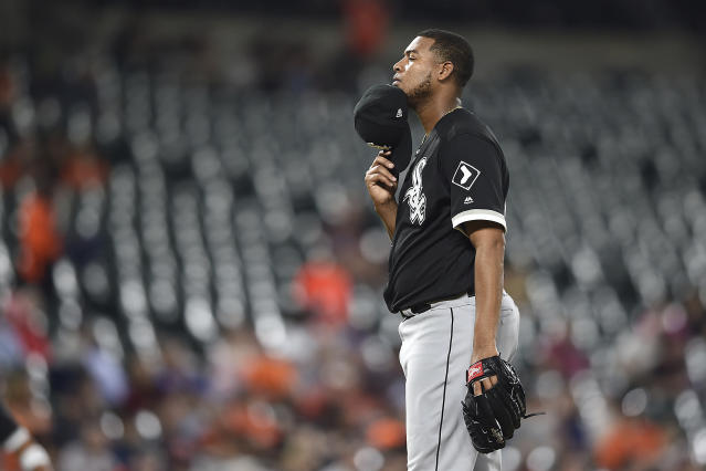 Chicago White Sox pitcher Ivan Nova pauses on the mound before throwing to the Baltimore Orioles in the fourth inning of a baseball game, Tuesday, April 23, 2019, in Baltimore. (AP Photo/Gail Burton)