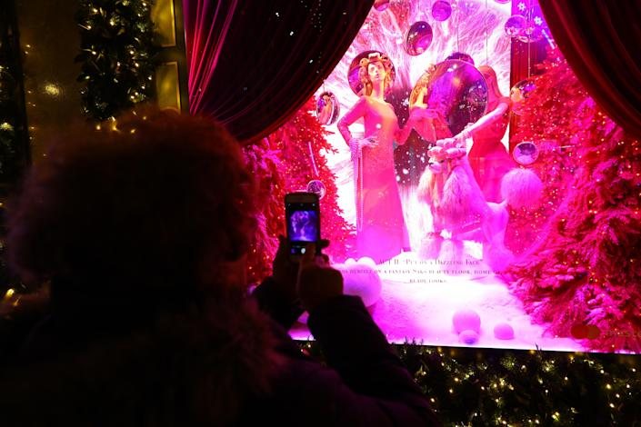 The holiday window displays at Saks Fifth Avenue make for festive photos. (Photo: Gordon Donovan/Yahoo News)