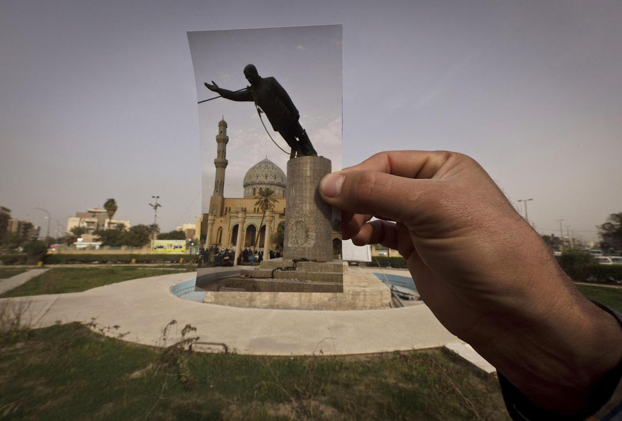 This Wednesday, March 13, 2013 photo shows a general view of Firdous Square at the site of an Associated Press photograph taken by Jerome Delay as the statue of Saddam Hussein is pulled down by U.S. forces and Iraqis on April 9, 2003. Ten years ago on live television, U.S. Marines memorably hauled down a Soviet-style statue of Saddam, symbolically ending his rule. Today, that pedestal in central Baghdad stands empty. Bent iron beams sprout from the top, and posters of anti-American Shiite cleric Muqtada al-Sadr in military fatigues are pasted on the sides.(AP Photo/Maya Alleruzzo)