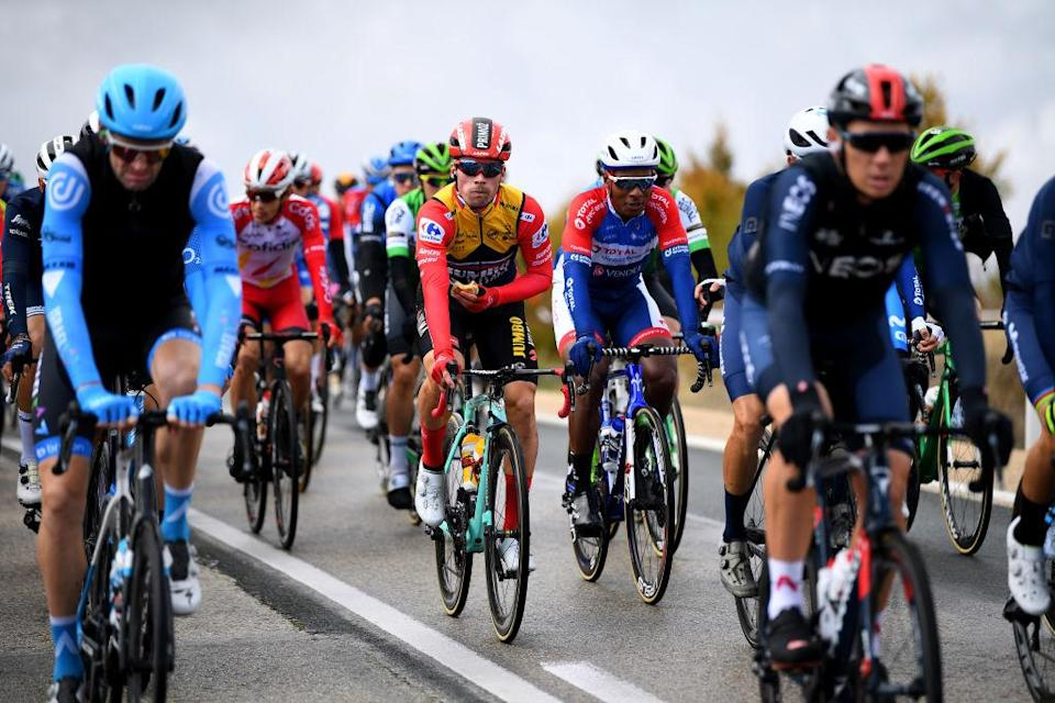 EJEADELOSCABALLEROS SPAIN  OCTOBER 23 Primoz Roglic of Slovenia and Team Jumbo  Visma Red Leader Jersey  Lorrenzo Manzin of France and Team Total Direct Energie  during the 75th Tour of Spain 2020 Stage 4 a 1917km stage from Garray  Numancia to Ejea de los Caballeros  lavuelta  LaVuelta20  La Vuelta  on October 23 2020 in Ejea de los Caballeros Spain Photo by David RamosGetty Images