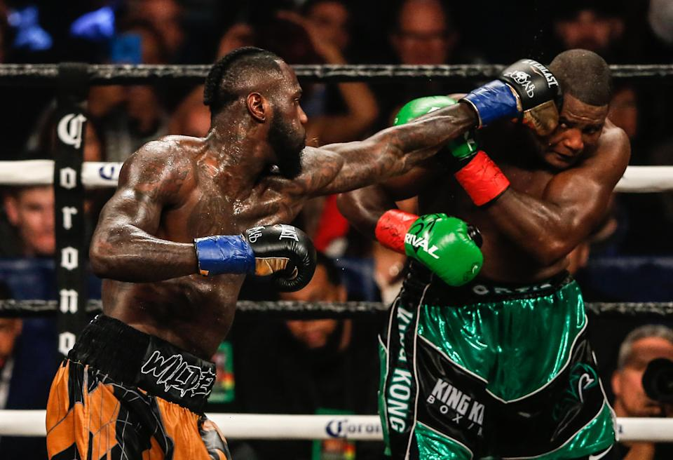 WBC heavyweight champion Deontay Wilder (L) lands a jab on Luis Ortiz Saturday at the Barclays Center in Brooklyn en route to a 10th round KO in a thrilling fight. (Getty Images)