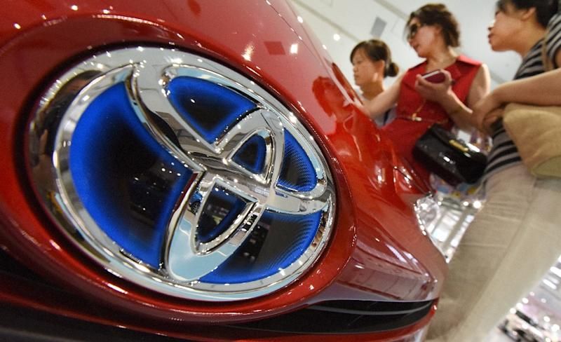 Toyota profits drop on stronger yen, lower sales