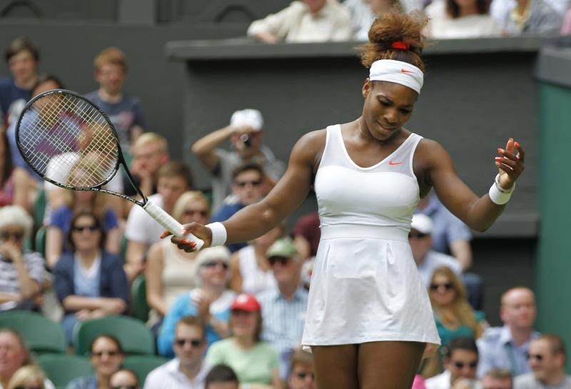 Serena Williams of the United States reacts as she plays Mandy Minella of Luxembourg in a Women's first round singles match at the All England Lawn Tennis Championships in Wimbledon, London, Tuesday, June 25, 2013. (AP Photo/Sang Tan)
