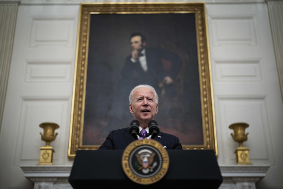 WASHINGTON, DC - JANUARY 21:  President Joe R. Biden, with Vice President Kamala Harris by his side, speaks about the COVID-19 coronavirus pandemic before signing executive orders in the State Dining Room at the White House on Thursday, Jan 21, 2021 in Washington, DC. (Photo by Jabin Botsford/The Washington Post via Getty Images)