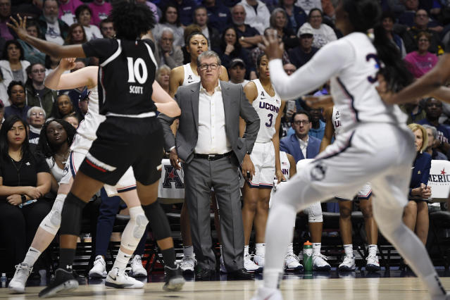 Connecticut head coach Geno Auriemma, center, watches play at the end of an NCAA college basketball game against Cincinnati in the American Athletic Conference tournament finals at Mohegan Sun Arena, Monday, March 9, 2020, in Uncasville, Conn. (AP Photo/Jessica Hill)