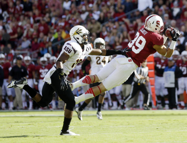 Stanford wide receiver Devon Cajuste, right, makes a catch in front of Arizona State safety Marcus Ball during the first half of an NCAA college football game Saturday, Sept. 21, 2013, in Stanford, Calif. (AP Photo/Marcio Jose Sanchez)