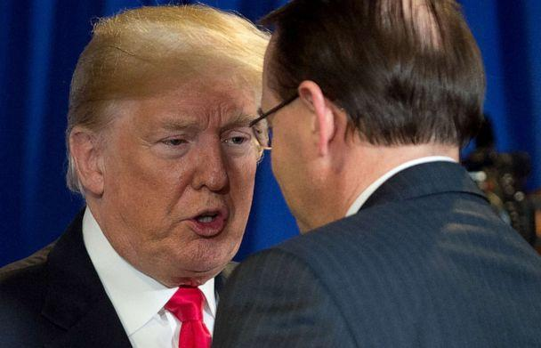 PHOTO: President Donald Trump speaks with Rod Rosenstein during a roundtable discussion on immigration at Morrelly Homeland Security Center in Bethpage, New York, May 23, 2018. (Saul Loeb/AFP/Getty Images, FILE)