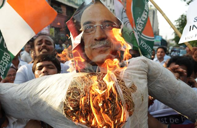 Indian activists burn an effigy of Pakistani president Asif Ali Zardari to protest against the killing of Indian prisoner Sarabjit Singh in Kolkata on May 2, 2013. An Indian man on death row in Pakistan for spying died nearly a week after he was attacked by fellow prisoners, who were swiftly charged with murder as New Delhi demanded justice. Sarabjit Singh, who was sentenced 16 years ago over alleged involvement in a deadly bombings, died in the early hours as a result of the savage assault in Lahore's Kot Lakhpat jail, a senior doctor at Jinnah hospital in the eastern city told AFP. AFP PHOTO/ Dibyangshu SARKAR (Photo credit should read DIBYANGSHU SARKAR/AFP/Getty Images)