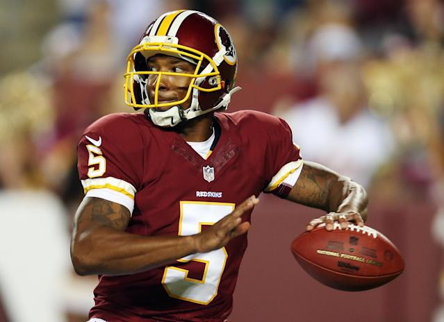 LANDOVER, MD - AUGUST 19: Quarterback Pat White #5 of the Washington Redskins drops back to pass against the Pittsburgh Steelers during the second half of a preseason game at FedExField on August 19, 2013 in Landover, Maryland. (Photo by Rob Carr/Getty Images)