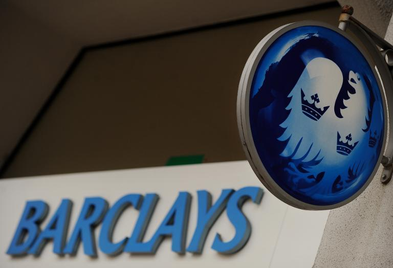 Barclays fell into a net loss last year, the British bank says, hit by huge costs linked to its alleged role in the rigging of foreign exchange markets