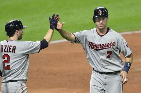 FILE PHOTO: Sep 26, 2017; Cleveland, OH, USA; Minnesota Twins first baseman Joe Mauer (7) celebrates with second baseman Brian Dozier (2) after scoring against the Cleveland Indians in the third inning at Progressive Field. Mandatory Credit: David Richard-USA TODAY Sports
