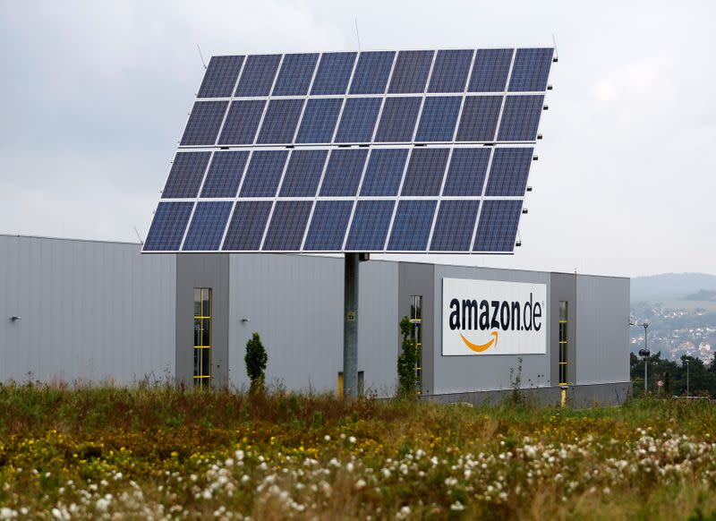 FILE PHOTO: Solar panels stand in front of the Amazon distribution centre in Bad Hersfeld