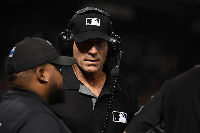 Third base umpire Angel Hernandez #5 wears headphones for a play review during a game between the Arizona Diamondbacks and the Texas Rangers at Chase Field on July 31, 2018 in Phoenix, Arizona. (Photo by Norm Hall/Getty Images)