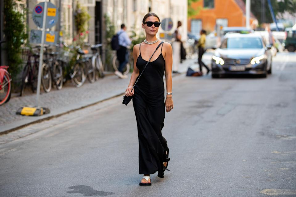 <p>The slip dress is one of the few items that's managed to achieve staple status in recent years. See, the mark of a true capsule piece is not just in its timeless appeal, but the ability to be dressed up and down effortlessly. Versatility is everything.</p><p>Back in the Nineties, when designers like Calvin Klein and Narciso Rodriguez introduced us to this 'underwear-as-outerwear' trend, it was seen as a risqué evening look – and most definitely not daywear. Things have since changed: in an ever decreasingly formal society (exacerbated by our current WFH situation), the boundaries between eveningwear and casualwear are blurring. </p><p>By ridding your wardrobe of its 'day' and 'night' limitations, you can get more experimental with weekend looks and shop more sustainably. And the slip dress epitomes this kind of fluid styling: cut from lustrous bias-cut fabric and strung from slender spaghetti straps, it has a louche elegance that's both sexy and grungy all at the same time. Depending on what you style it with, of course. </p><p>Worn solo it can be strikingly minimalist (just add a sleek bun and strappy sandals) or rebellious (think Doc Martens). But most impressive of all, is this piece's multitasking abilities – throw a blazer over the top to create structure, underpin it with white T-shirts and black turtlenecks, or layer a sweater over the top to create an on-trend slip skirt. Then, simply swap between heels, boots and trainers depending on the occasion.</p><p>Naturally, we'd recommend starting with a simple black number for maximum versatility, but more playful designs from the likes of Cushnie, Dannijo and Ann Demeulemeester are hard to resist. We can assure you, whichever you opt to buy, it will still be bang on trend in years to come – that's the beauty of a true staple.</p>
