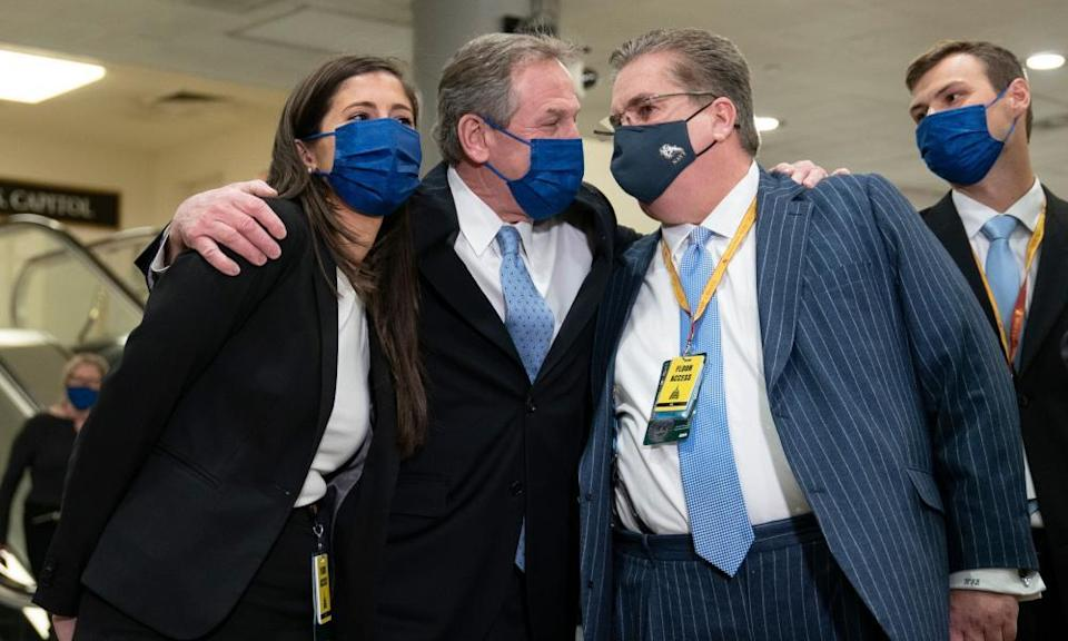 Trump's lawyers celebrate his acquittal.