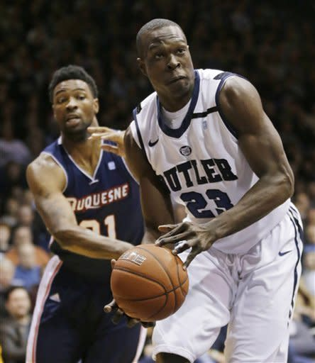 Duquesne forward Quevyn Winters, left, knocks the ball away from Butler forward Khyle Marshall during the first half of an NCAA college basketball game in Indianapolis, Tuesday, Feb. 19, 2013. (AP Photo/Michael Conroy)