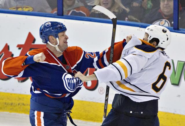 Buffalo Sabres' Mike Weber (6) and Edmonton Oilers' Matt Hendricks (23) fight during the third period of an NHL hockey game Thursday, March 20, 2014, in Edmonton, Alberta. Buffalo won 3-1. (AP Photo/The Canadian Press, Jason Franson)