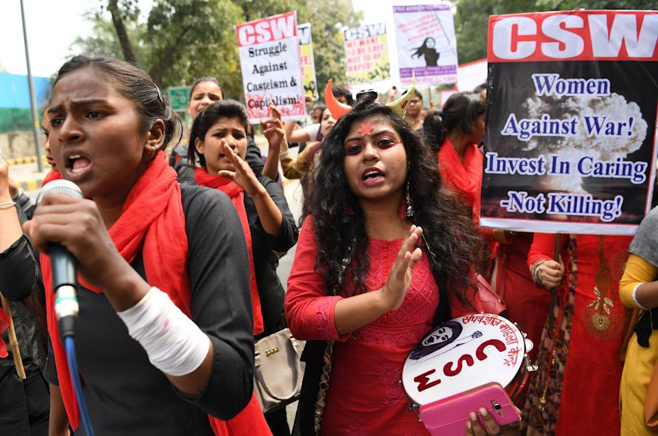 Indian women shout slogans at a march to mark International Women's Day in New Delhi on March 8, 2019. A women from a scheduled tribe in India was beaten, stripped and paraded naked through the village for 'having an extra-marital affair' (AFP via Getty Images)