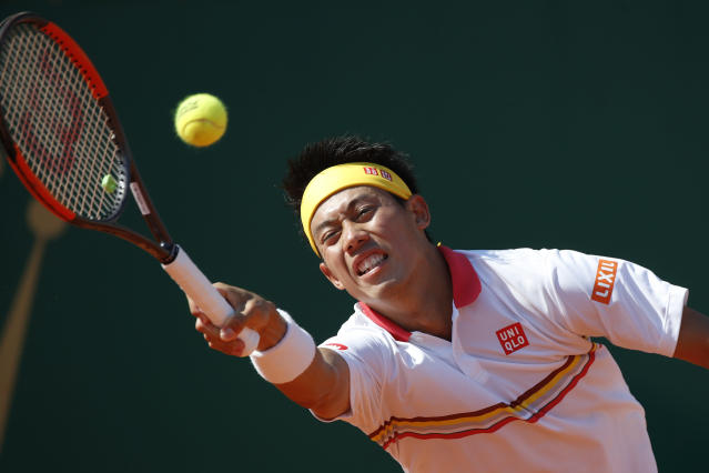 Japan's Kei Nishikori reaches to return against Spain's Rafael Nadal during the men's singles final match of the Monte Carlo Tennis Masters tournament in Monaco, Sunday April 22, 2018. (AP Photo/Christophe Ena)