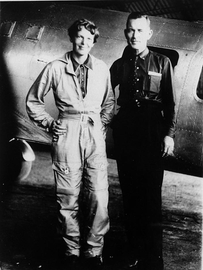 FILE - In this May 1937 file photo, aviator Amelia Earhart and her navigator, Fred Noonan, pose in front of their twin-engine Lockheed Electra in Los Angeles, prior to their historic flight in which Earhart was attempting to become first female pilot to circle the globe. A $2.2 million expedition that hoped to find wreckage from famed aviator Amelia Earhart's final flight is on its way back to Hawaii without the dramatic, conclusive plane images searchers were hoping to attain. But the group leading the search, The International Group for Historic Aircraft Recovery, still believes Earhart and her navigator crashed onto a reef off a remote island in the Pacific Ocean 75 years ago this month, its president told The Associated Press on Monday, July 23, 2012. (AP Photo, File)