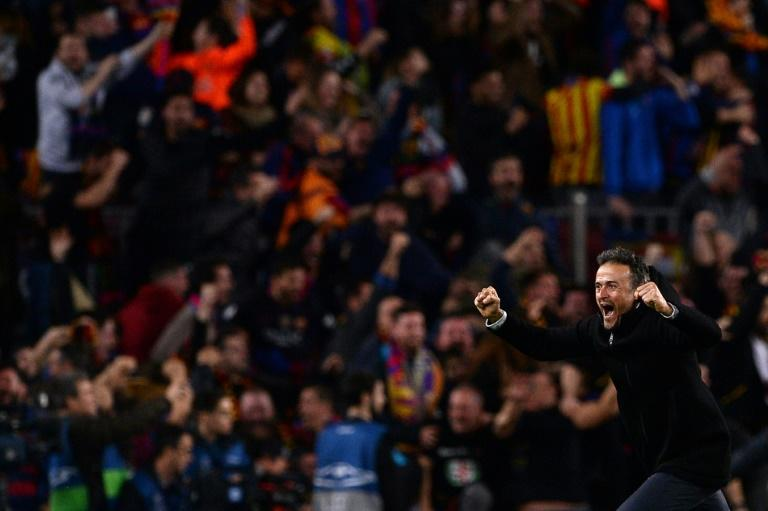 Barcelona coach Luis Enrique celebrates their 6-1 victory over Paris Saint-Germain after their Champions League match at the Nou Camp stadium on March 8, 2017