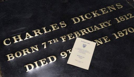"""The gravestone of British author Charles Dickens at Westminster Abbey in London on Tuesday with a program detailing a ceremony to mark the bicentenary of Dickens' birth. Prince Charles and Ralph Fiennes, who is starring in the latest film version of Dickens' masterpiece """"Great Expectations"""", attended the ceremony in Poets' Corner at the abbey, where Dickens was buried in 1870"""