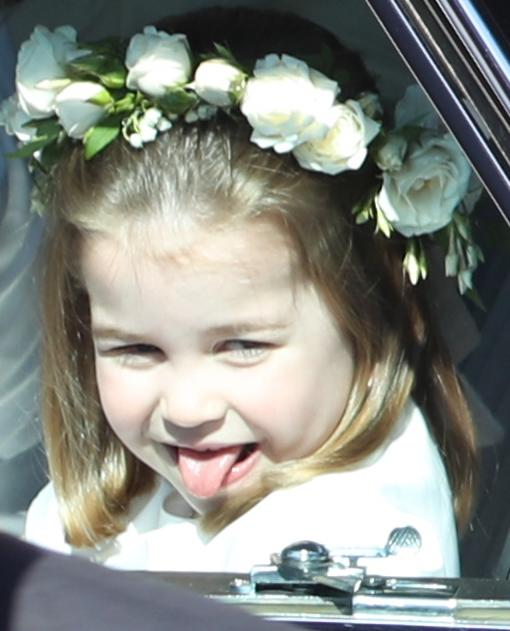 <p>Princess Charlotte sticks her tongue out at Meghan and Harry's wedding (PA) </p>