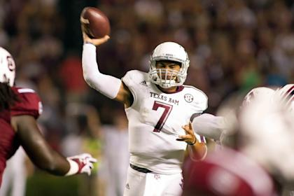Texas A&M Aggies QB Kenny Hill (7) had a record-setting night in his debut. (USA Today)