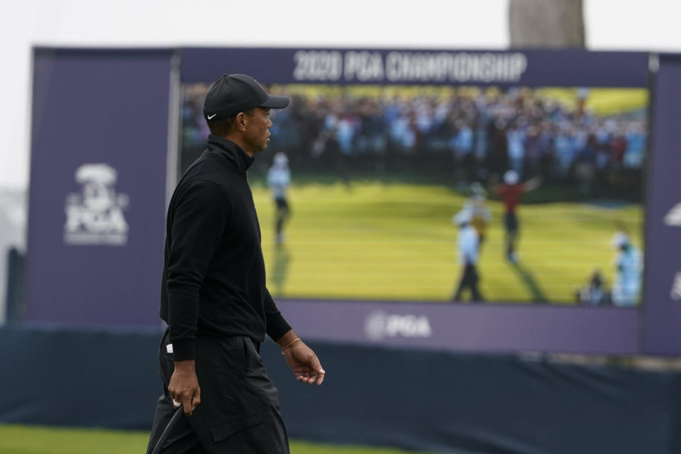 Tiger Woods walks past the scoreboard on the 17th hold during a practice round for the PGA Championship golf tournament at TPC Harding Park Wednesday, Aug. 5, 2020, in San Francisco. (AP Photo/Charlie Riedel)