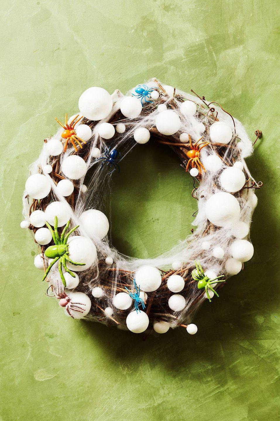 """<p>Here's a DIY project your child wouldn't mind tackling. After spray-painting plastic spiders and Styrofoam balls, attach then to a twig wreath form and finish the look with gauzy spiderweb material. </p><p><a class=""""link rapid-noclick-resp"""" href=""""https://www.amazon.com/Muzboo-Realistic-Plastic-Halloween-Decorations/dp/B07CVJ3LBN?tag=syn-yahoo-20&ascsubtag=%5Bartid%7C10055.g.4602%5Bsrc%7Cyahoo-us"""" rel=""""nofollow noopener"""" target=""""_blank"""" data-ylk=""""slk:SHOP FAKE SPIDERS"""">SHOP FAKE SPIDERS </a></p>"""