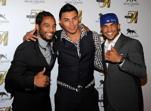 LAS VEGAS, NV - SEPTEMBER 18: (L-R) Victor Ortiz's sparring partner Karl Dargan, Temo Ortiz and his brother, boxer Victor Ortiz, arrive at a post-fight party at Studio 54 inside the MGM Grand Hotel/Casino early on September 18, 2011 in Las Vegas, Nevada. Victor Ortiz lost the WBC welterweight title to Floyd Mayweather Jr. by fourth-round knockout on September 17. (Photo by Ethan Miller/Getty Images for Studio 54)