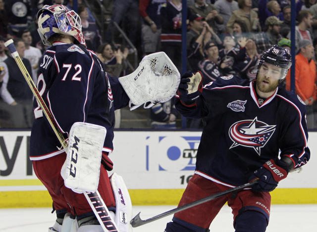 Columbus Blue Jackets' David Savard, right, congratulates teammate Sergei Bobrovsky, of Russia, on his win over the Buffalo Sabres in an NHL hockey game Friday, April 10, 2015, in Columbus, Ohio. The Blue Jackets won 4-2. (AP Photo/Jay LaPrete)