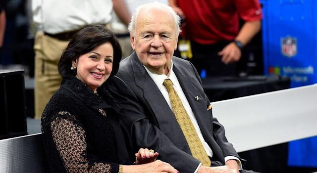 Ties between local church leaders and the Saints include a close friendship between New Orleans Archbishop Gregory Aymond and Gayle Benson (left), who inherited the Saints and the New Orleans Pelicans basketball team when her husband, Tom Benson (right), died in 2018. (AP Images)
