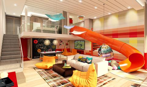 The new family suite on board Symphony of the Seas will feature an in-room slide