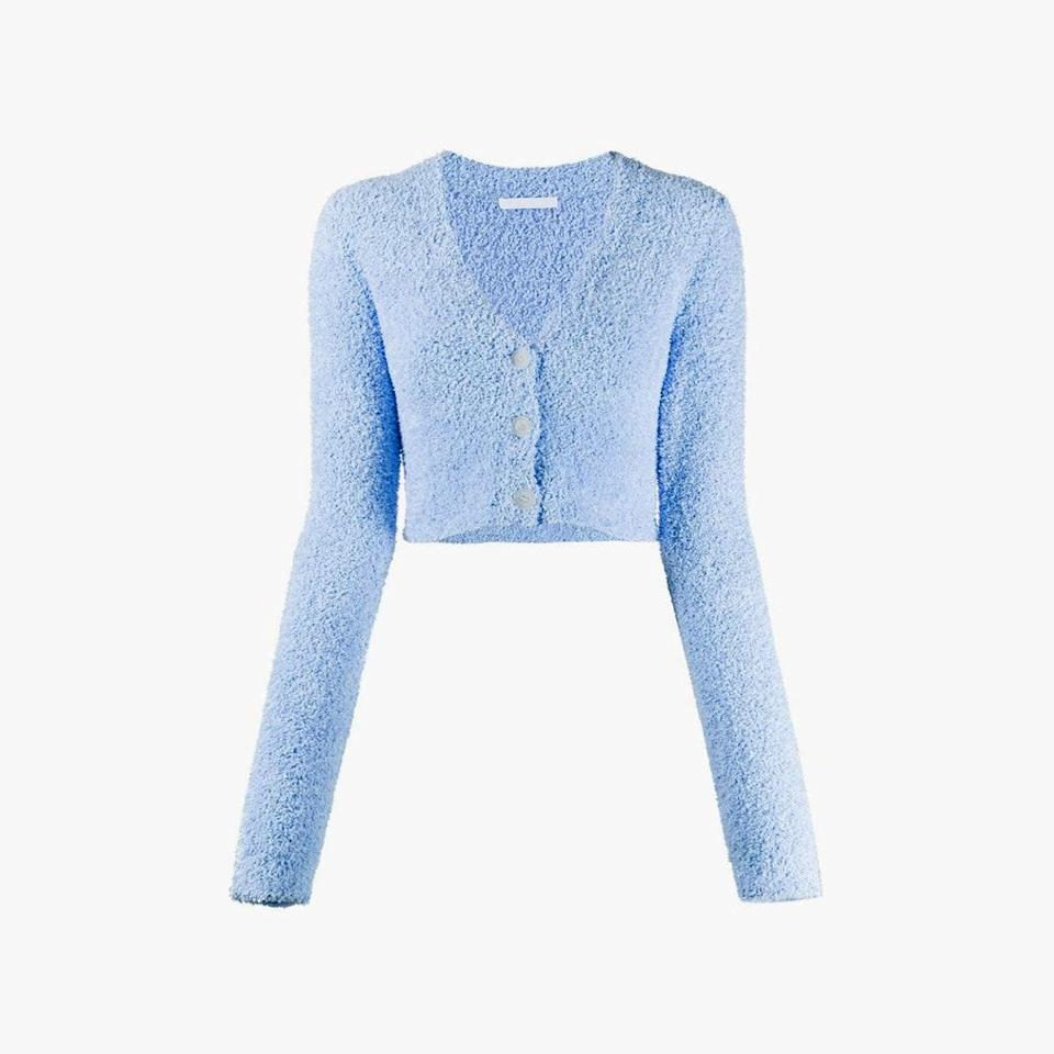"""If the baby blue color isn't enough, you'll definitely fall in love with the boucle texture on this beauty. $380, LN-CC. <a href=""""https://www.ln-cc.com/en/women/clothing/knitwear/textured-knit-cardigan-in-blue-09883389773969.html"""" rel=""""nofollow noopener"""" target=""""_blank"""" data-ylk=""""slk:Get it now!"""" class=""""link rapid-noclick-resp"""">Get it now!</a>"""
