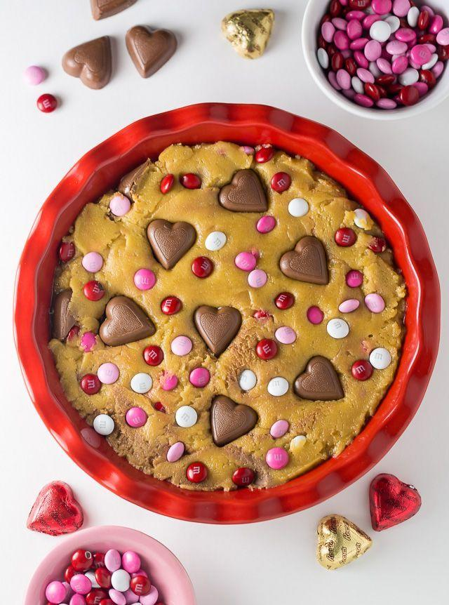 "<p>Any cookie pie is a heavenly treat, but this one is stuffed with Valentine's Day candies that makes it even better.</p><p><strong>Get the recipe at <a href=""https://bakerbynature.com/valentines-day-cookie-pie/"" rel=""nofollow noopener"" target=""_blank"" data-ylk=""slk:Baker by Nature"" class=""link rapid-noclick-resp"">Baker by Nature</a>.</strong></p><p><strong><a class=""link rapid-noclick-resp"" href=""https://www.amazon.com/Sweese-518-101-Porcelain-Baking-Ruffled/dp/B07Y35SGP6/?tag=syn-yahoo-20&ascsubtag=%5Bartid%7C10050.g.1138%5Bsrc%7Cyahoo-us"" rel=""nofollow noopener"" target=""_blank"" data-ylk=""slk:SHOP PIE PLATES"">SHOP PIE PLATES</a><br></strong></p>"