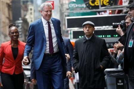 New York City Mayor Bill de Blasio and his wife Chirlane McCray, after announcing his candidacy for the Democratic presidential nomination with a central campaign message, arrive at the Good Morning America show in New York City, U.S., May 16, 2019. REUTERS/Shannon Stapleton