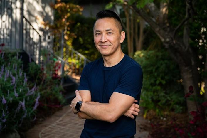 "PASADENA, CA - OCTOBER 20: Pulitzer Prize-winning author Viet Thanh Nguyen is photographed in the backyard of his Pasadena, CA, home, Tuesday, Oct. 20, 2020. Nguyen and his son, Ellison, wrote a children's book together, ""Chicken of the Sea,"" and will take part in the Los Angele Times Festival of Books. (Jay L. Clendenin / Los Angeles Times)"