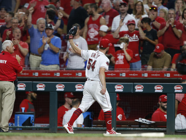 Cincinnati Reds starting pitcher Sonny Gray (54) acknowledges the fans as he leaves the field in the eighth inning of a baseball game against the Milwaukee Brewers, Wednesday, July 3, 2019, in Cincinnati. Gray pitched 8 shut-out innings in the Reds 3-0 win. (AP Photo/Gary Landers)