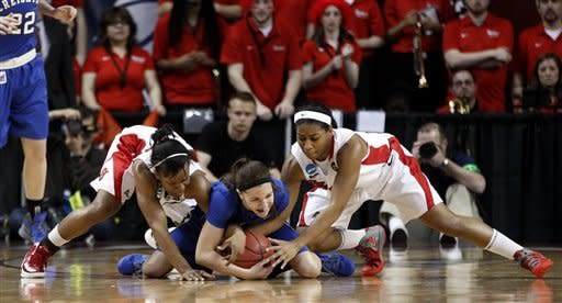 St. John's guard Eugeneia McPherson, left, Creighton guard Jasmin Corbin, center, and St. John's guard Nadirah McKenith scramble for the ball in the first half of an NCAA tournament first-round women's college basketball game in Norman, Okla., Sunday, March 18, 2012. (AP Photo/Sue Ogrocki)